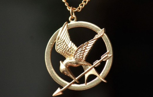 This is the iconic mockingjay pendant Katniss wears during the Hunger Games, and which soon becomes a symbol of her revolution.