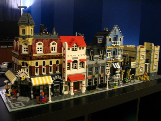 A collector's personal LEGO avenue, with a Cafe Corner on the far left, connected to houses of his own design.